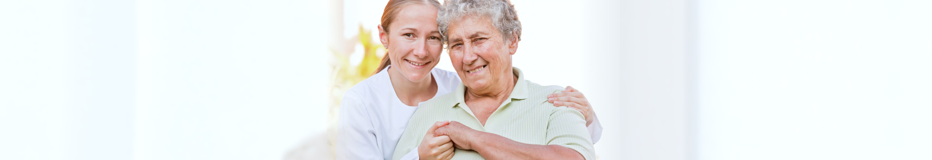 caregiver smiling with senior woman